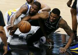 Golden State Warriors� Kevin Durant and San Antonio Spurs� Rudy Gay scramble for a loose ball during the first half at the AT&T Center, Sunday, April 22, 2018.