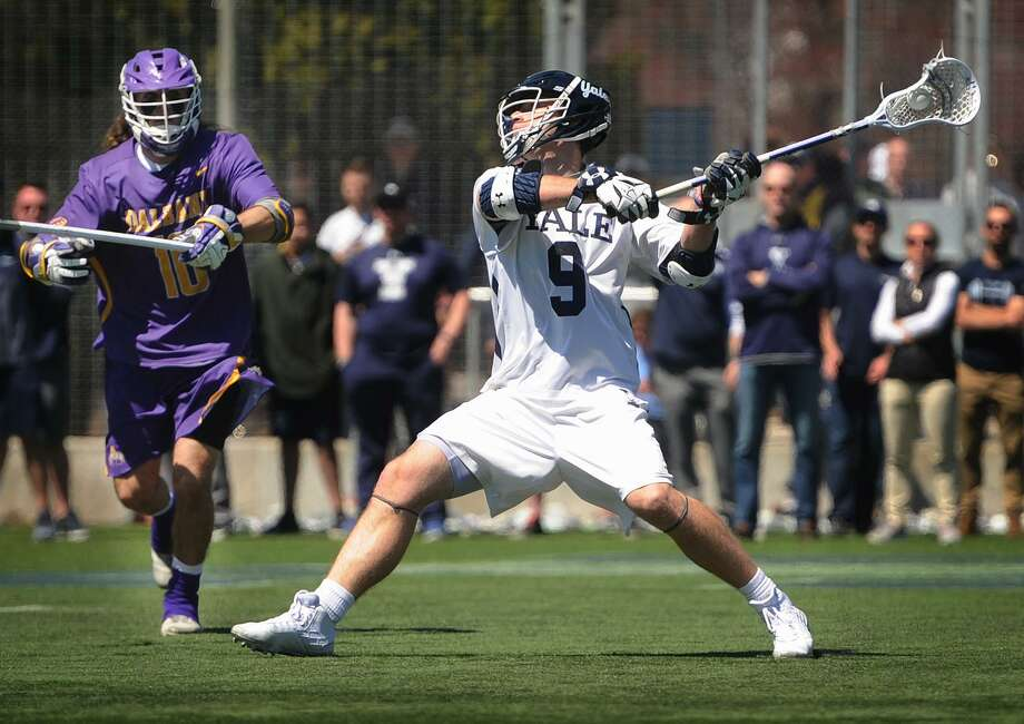 Yale's Lucas Cotler fires a shot as Albany's Troy Reh looks on during Sunday's matchup in New Haven. Photo: Brian A. Pounds / Hearst Connecticut Media / Connecticut Post