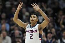 Connecticut's Jalen Adams gestures after hitting a three-point basket in the second half of an NCAA college basketball game against Memphis, Saturday, Jan. 9, 2016, in Storrs, Conn. UConn won 81-78. (AP Photo/Jessica Hill)