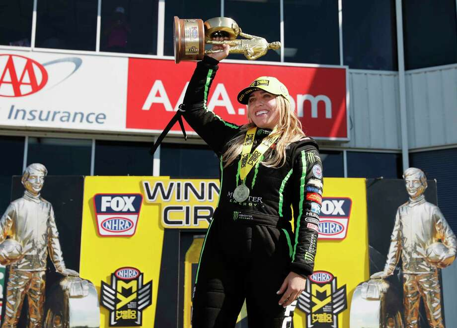 Top Fuel driver Brittany Force celebrates with the championship trophy after the the 31st annual NHRA SpringNationals at the Royal Purple Raceway on Sunday, April 22, 2018 in Baytown, TX. Photo: Tim Warner, For The Chronicle / Houston Chronicle