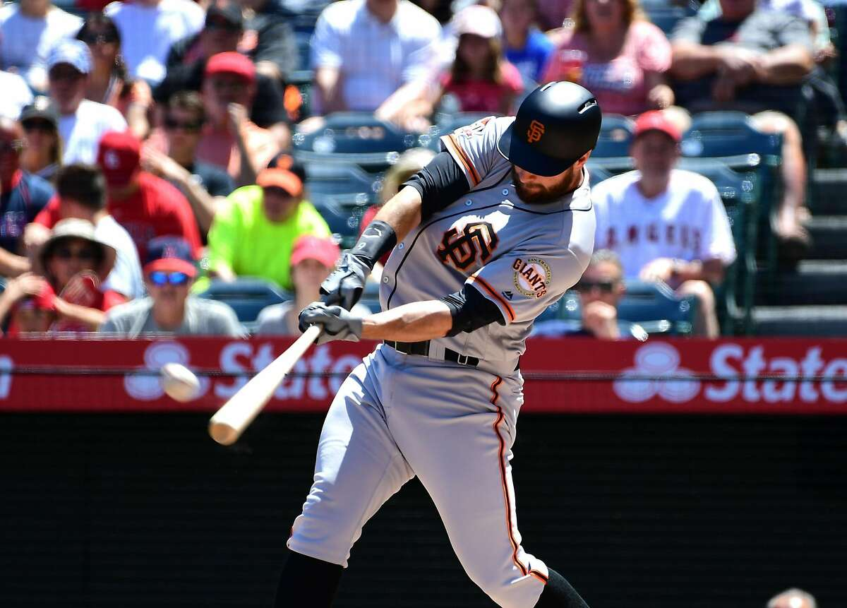 Brandon Belt of the San Francisco Giants flys out after setting a new MLB record with a 21 pitch at bat in the first inning of the game off against the Los Angeles Angels of Anaheim.