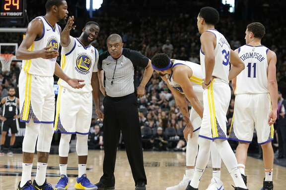 Warriors players question the referee about a technical called on David West as the Spurs host Golden State in game 4 of the first round of Western Conference NBA playoffs at the AT&T Center on April 22, 2018.