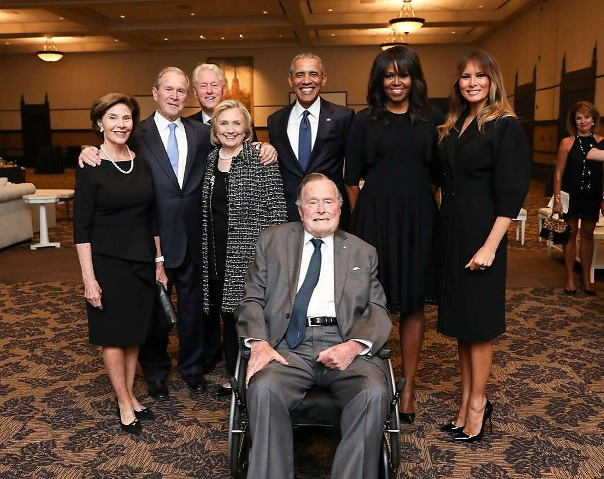 On Sunday, former President George H.W. Bush's office released a photo of first lady Melania Trump standing next to Michelle Obama, Barack Obama, Hillary Clinton, Bill Clinton, George W. Bush and Laura Bush, who all appear in front of George H.W. Bush. They were together at a reception before former first lady Barbara Bush's funeral in Houston, Saturday, April 21, 2018. Bush was hospitalized on Sunday with an infection that spread to his bloodstream, but was recovering Monday. >>More photos of Houston honoring Barbara Bush