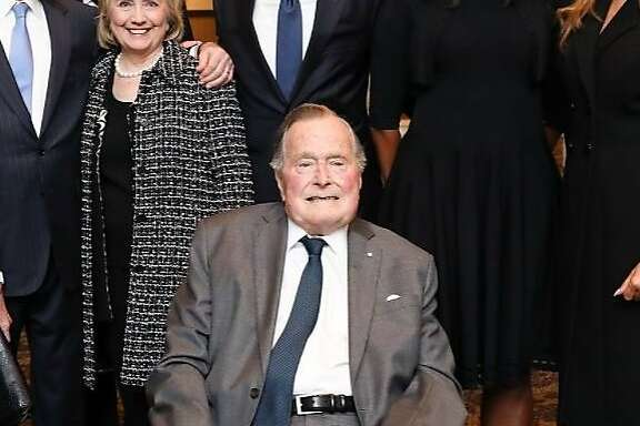 On Sunday, former President George H.W. Bush's office released a photo of first lady Melania Trump standing next to Michelle Obama, Barack Obama, Hillary Clinton,  Bill Clinton,  George W. Bush and Laura Bush, who all appear in front of George H.W. Bush. They were together at a reception before former first lady Barbara Bush's funeral in Houston, Saturday, April 21, 2018. (Paul Morse for the Office of President George H.W. Bush)
