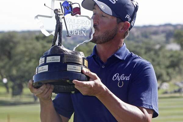 Andrew Landry kisses the trophy for the Valero Texas Open, Sunday, April 22, 2018, in San Antonio. Landry won with a score of 17 under par. (AP Photo/Michael Thomas)