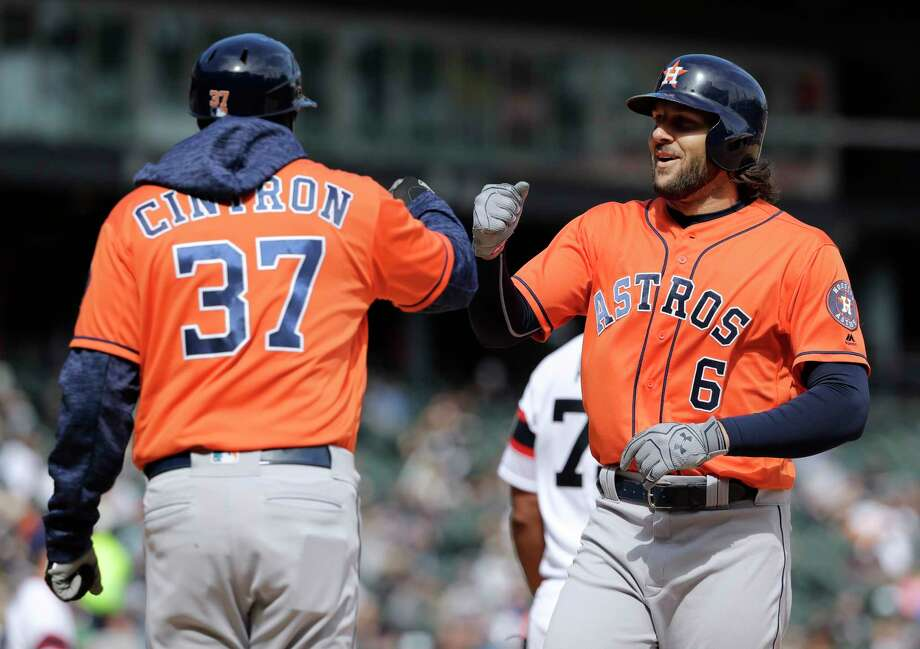 Houston Astros' Jake Marisnick, right, celebrates with first base coach Alex Cintron after hitting a single against the Chicago White Sox during the seventh inning of a baseball game Sunday, April 22, 2018, in Chicago. (AP Photo/Nam Y. Huh) Photo: Nam Y. Huh, STF / Copyright 2018 The Associated Press. All rights reserved.