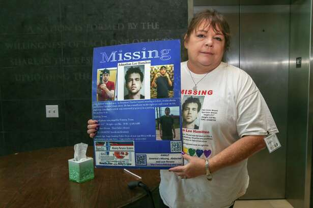 """April 22, 2018:   Angie Hamilton holds up a poster of her missing son Jonathan Lee Hamilton during the """"Missing in Harris County Day"""" event held in the Barbara Jordan-Mickey Leland School of Public Affairs at the Texas Southern University campus in Houston, Texas.  (Leslie Plaza Johnson/Freelance"""