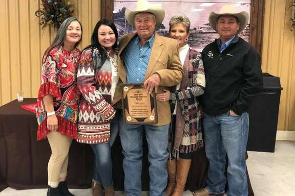Winston Sizemore Sr.  is surrounded by his family members after receiving the Trinity Valley  Exposition's Western Heritage Award. Pictured with him are daughters Marie Sizemore and Kim Wright, wife Sharlett Sizemore and son Winston Sizemore Jr.