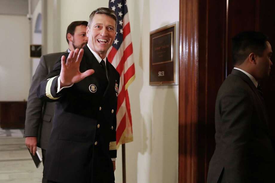 WASHINGTON, DC - APRIL 16:  Physician to the President U.S. Navy Rear Admiral Ronny Jackson waves to journalists as he heads into a meeting with Senate Veterans Affairs Committee Chairman Johnny Isakson (R-GA) in the Russell Senate Office Building on Capitol Hill April 16, 2018 in Washington, DC. President Donald Trump nominated Jackson, his personal doctor at the White House, to be the new Secretary of the Department of Veterans Affairs after Trump fired David Shulkin on March 28.  (Photo by Chip Somodevilla/Getty Images) Photo: Chip Somodevilla / 2018 Getty Images