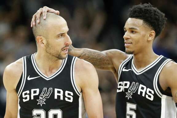 San Antonio Spurs guard Manu Ginobili (20) celebrates with teammate guard Dejounte Murray (5) after making a basket late in second half action of Game 4 against the Golden State Warriors, Sunday April 22, 2018 at the AT&T Center. The Spurs won 103-90.