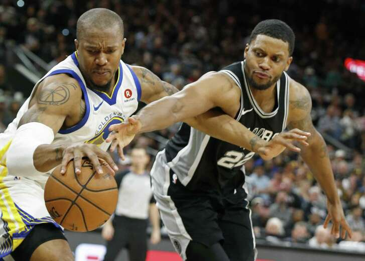 Golden State Warriors forward David West (3) and San Antonio Spurs forward Rudy Gay (22) grab for a loose ball during second half action of Game 4 Sunday April 22, 2018 at the AT&T Center. The Spurs won 103-90.