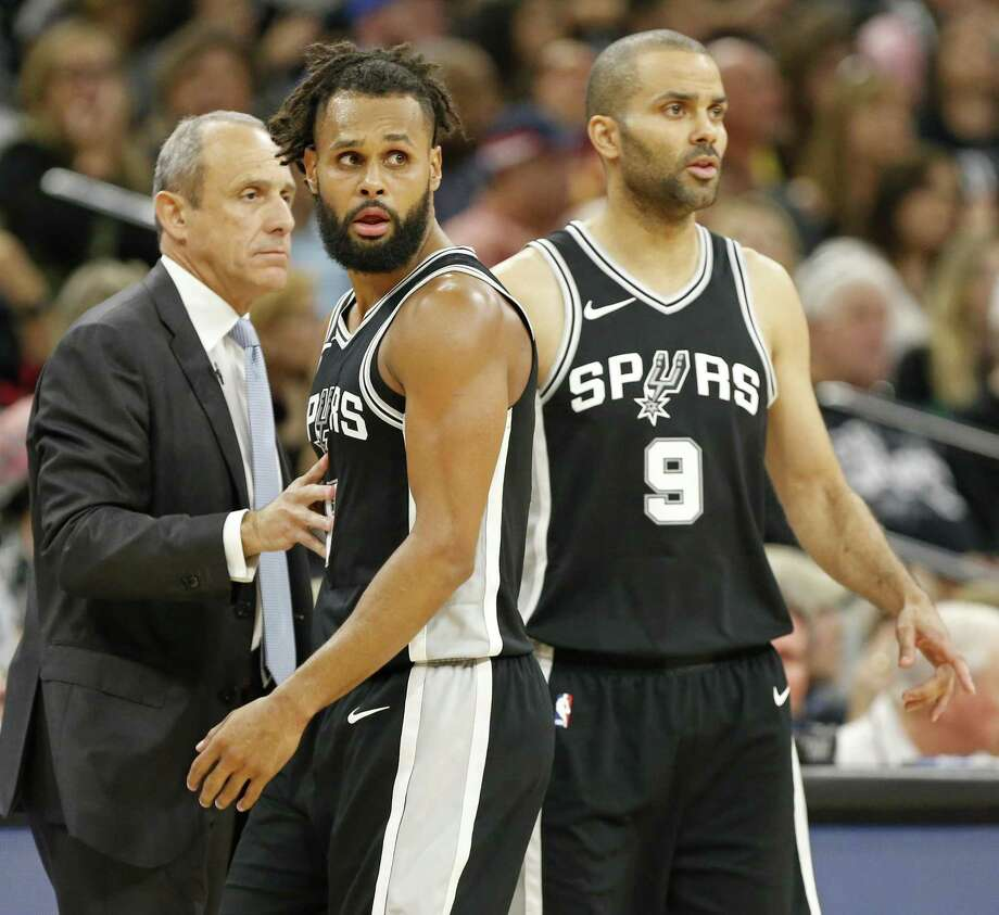 San Antonio Spurs assistant coach Ettore Messina talks with guard Patty Mills (8) and  guard Tony Parker (9) during second half action of Game 4 against the Golden State Warriors Sunday April 22, 2018 at the AT&T Center. The Spurs won 103-90. Photo: Edward A. Ornelas, Staff / San Antonio Express-News / © 2018 San Antonio Express-News