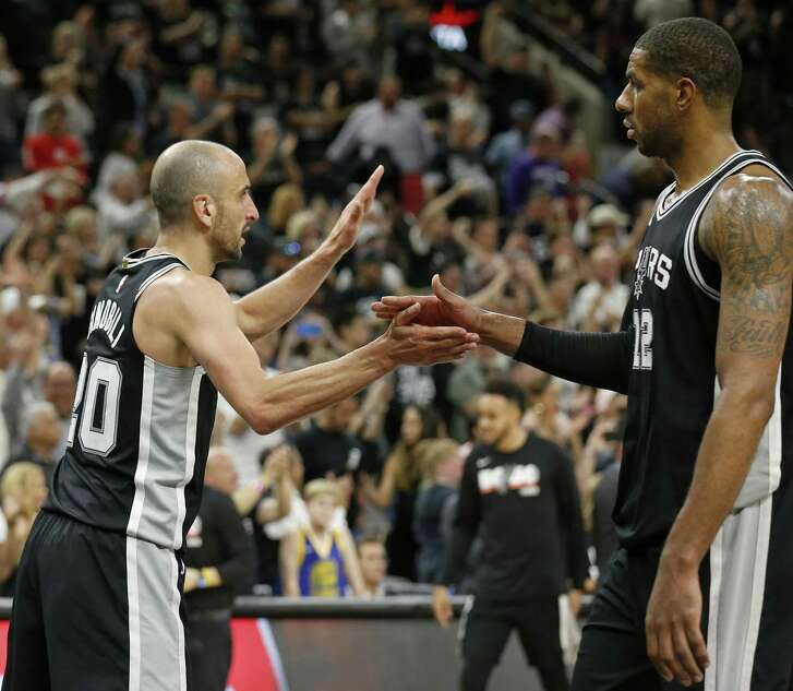 San Antonio Spurs guard Manu Ginobili (20) greets forward LaMarcus Aldridge (12) after Game 4 against the Golden State Warriors, Sunday April 22, 2018 at the AT&T Center. The Spurs won 103-90.