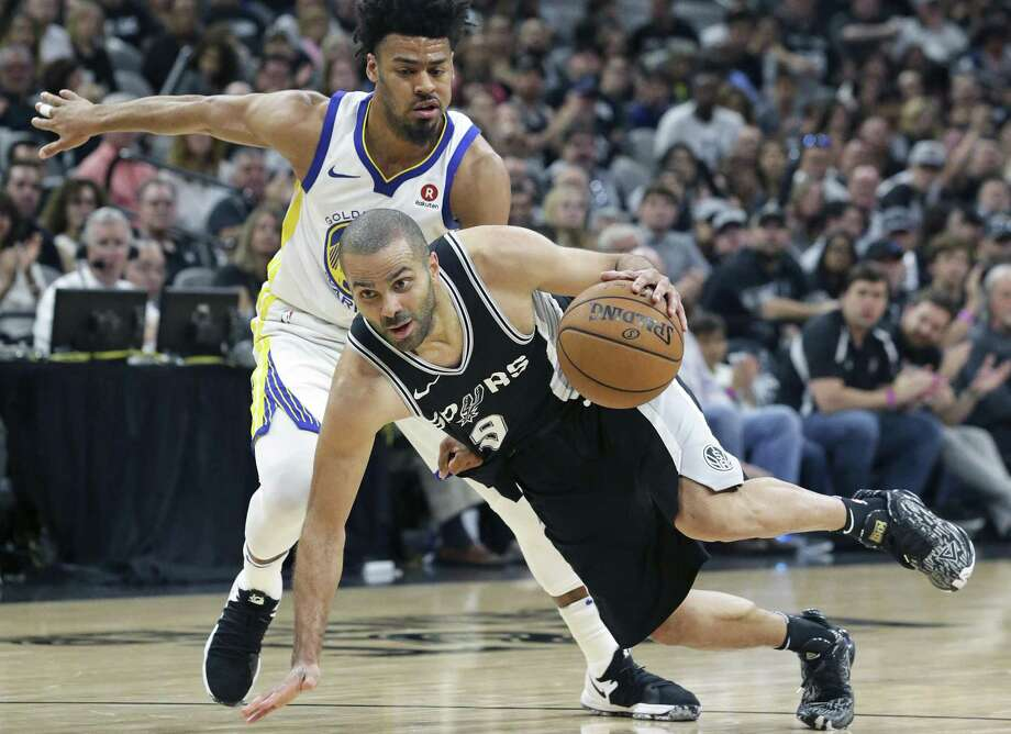Tony Parker spins and gets in front of Quinn Cook in the second half the Spurs host Golden State in game 4 of the first round of Western Conference NBA playoffs at the AT&T Center on April 22, 2018. Photo: Tom Reel, Staff / San Antonio Express-News / 2017 SAN ANTONIO EXPRESS-NEWS