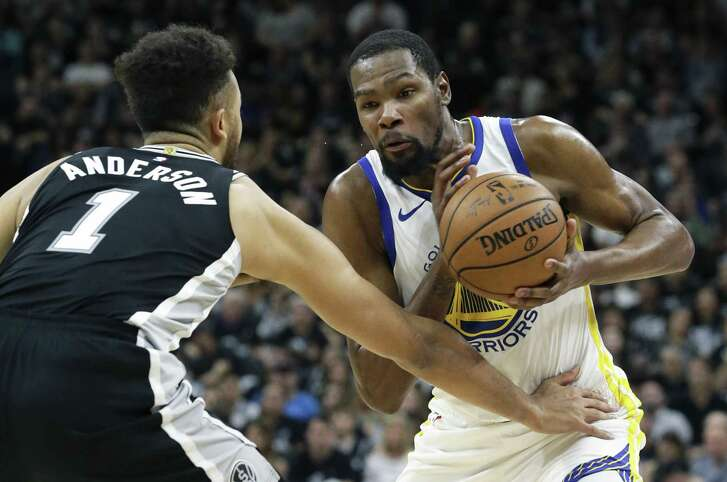 Kevin Durant fumbles the ball against Kyle Anderson as the Spurs host Golden State in game 4 of the first round of Western Conference NBA playoffs at the AT&T Center on April 22, 2018.
