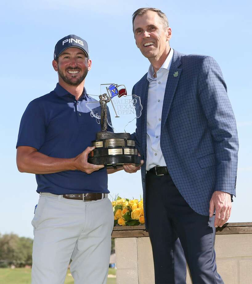 Andrew Landry (left) receives the championship trophy from Valero's Martin Parrish, Vice President Alternative Fuels, after winning the Texas Open at TPC San Antonio on Sunday, April 22, 2018. Landry shot a 4-under 68 on the final day, finishing 17-under to win the tournament, his first PGA Tour victory. MARVIN PFEIFFER/mpfeiffer@express-news.net Photo: Marvin Pfeiffer, Staff / San Antonio Express-News / Express-News 2018