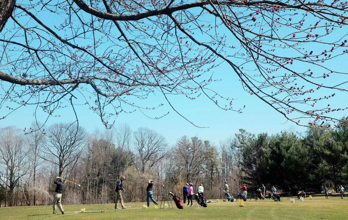 Golfers practice hitting on the driving range on opening day at Western Turnpike Golf Course on Sunday, April 22, 2018, in Guilderland, N.Y. New this year at the golf course, players can set up tee times any time day or night through the course's website. The course is also partnering with the smartphone app GolfStatus, which allows players to use the app as their score card and it also allows the course to send out special offers to players. (Paul Buckowski/Times Union)