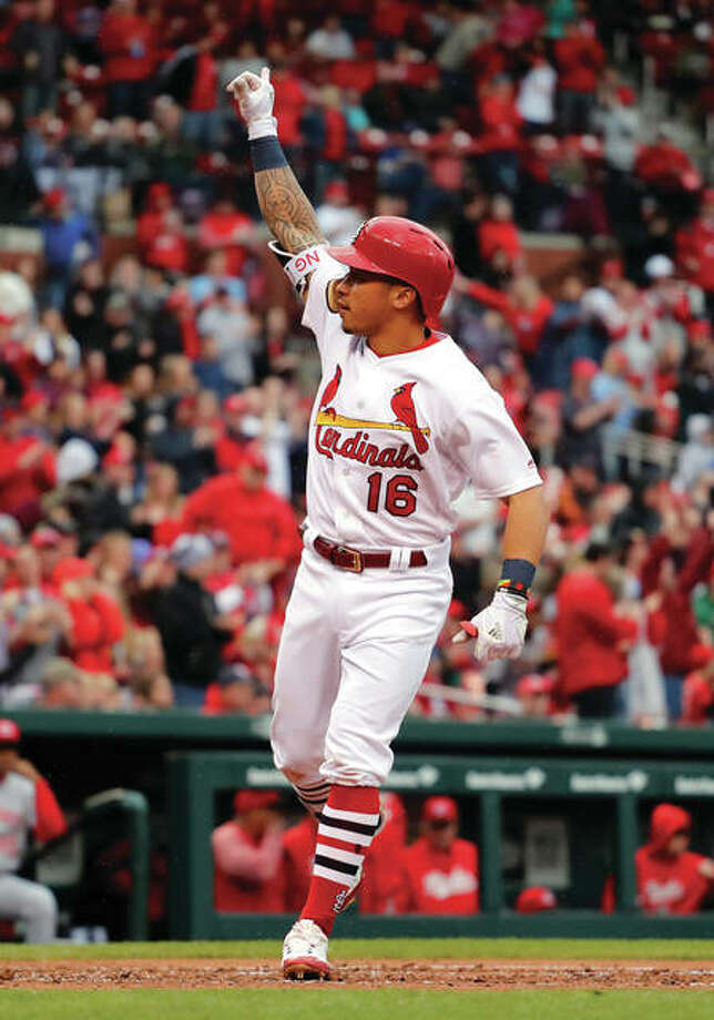 The Cardinals' Kolten Wong arrives home after hitting a solo home run during the second inning against the Cincinnati Reds on Sunday at Busch Stadium. Photo:       AP