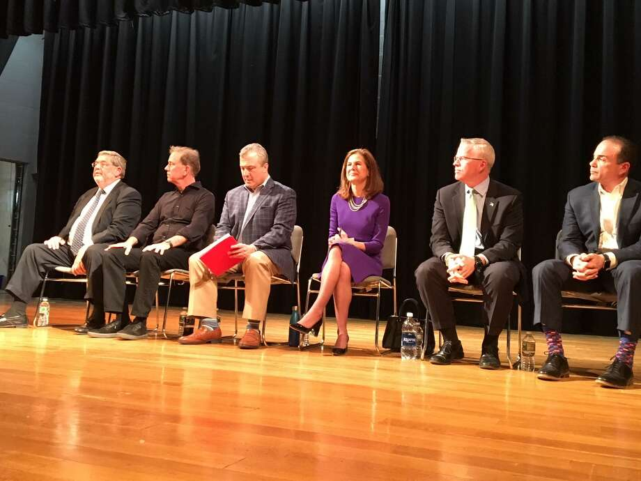 Six of the Democratic candidates for governor took questions at a forum at New Haven's Career High School Sunday. They are from left: Greenwich businessman Gus Smith; former U.S. Senate candidate Ned Lamont; former consumer protection commissioner Jonathan Harris; former Secretary of the State Susan Bysiewicz; John Connolly, former head of Veterans Affairs; and Bridgeport Mayor Joe Ganim. Photo: Mary E. O'Leary / Hearst Connecticut Media