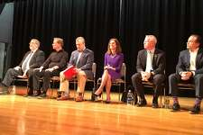 Six of the Democratic candidates for governor took questions at a forum at New Haven's Career High School Sunday. They are from left: Greenwich businessman Gus Smith; former U.S. Senate candidate Ned Lamont; former consumer protection commissioner Jonathan Harris; former Secretary of the State Susan Bysiewicz; John Connolly, former head of Veterans Affairs; and Bridgeport Mayor Joe Ganim.
