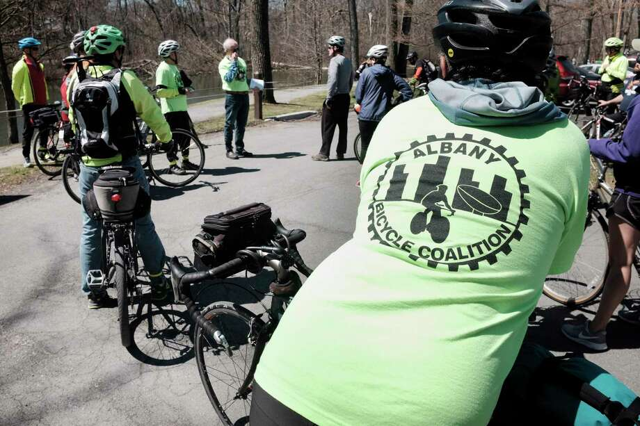 Bicycle riders make a stop at Buckingham Pond during the City of AlbanyOs Annual Earth Day Bicycle Ride on Sunday, April 22, 2018, in Albany, N.Y. The ride began in Washington Park and the riders made their way to Lincoln Park and Buckingham Pond, stopping along the way to learn a little history about different areas of Albany. The ride was put on by the Albany Bicycle Coalition, a community of bicycle activists.  (Paul Buckowski/Times Union) Photo: PAUL BUCKOWSKI / (Paul Buckowski/Times Union)