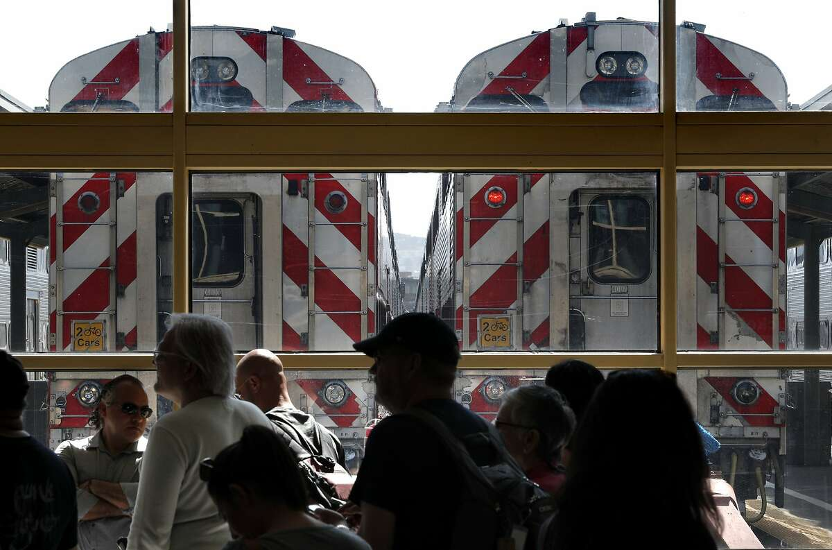 Passengers wait for their trains at the Caltrain rail station in San Francisco, Calif., on Sunday, April 22, 2018. A new report for a planned rail extension into downtown would now eliminate the need to demolish the I-280 extension, as previously proposed.