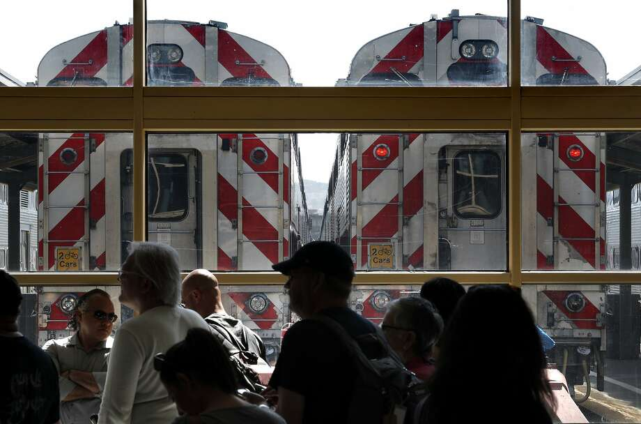 Passengers wait for their trains at the Caltrain rail station in San Francisco, Calif., on Sunday, April 22, 2018. A new report for a planned rail extension into downtown would now eliminate the need to demolish the I-280 extension, as previously proposed. Photo: Carlos Avila Gonzalez / The Chronicle