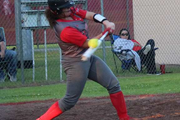 Cleveland Lady Indian Bella Buckley (8) takes a swing at an incoming softball during the April 17 game against the Huffman Lady Falcons.
