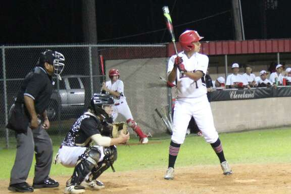 Cleveland Indian Christian Botello (right) steps up to bat for the team against the Huffman Falcons during the April 17 baseball game.