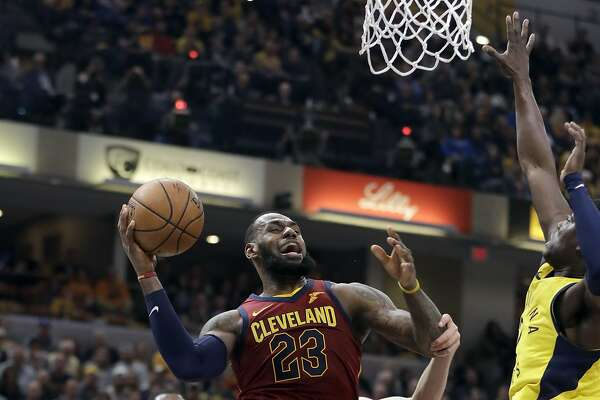 Cleveland Cavaliers' LeBron James (23) heads to the basket as Indiana Pacers' Darren Collison, right, defends during the first half of Game 4 of a first-round NBA basketball playoff series, Sunday, April 22, 2018, in Indianapolis. (AP Photo/Darron Cummings)