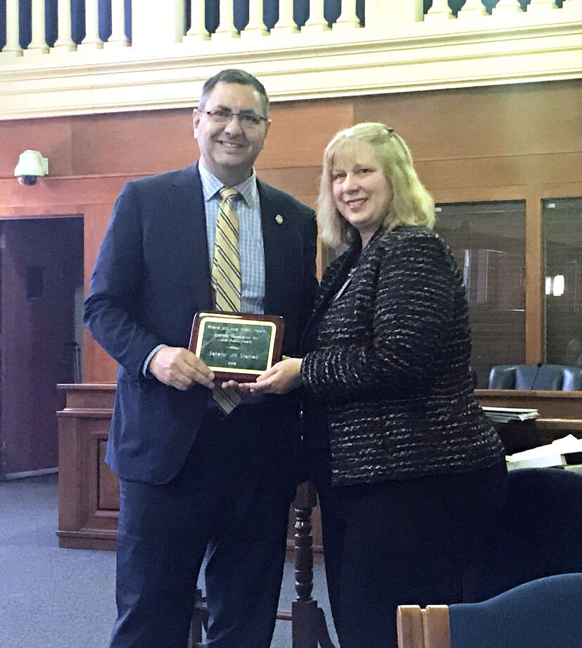 State Sen. Jim Stamas receives the Michigan Association of Local Public Health's Friend of Local Public Health Award from Denise Bryan, health officer for District Health Department No. 2 and No. 4. (Photo provided)