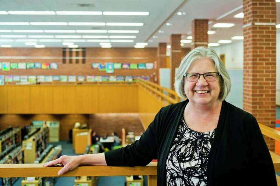 Melissa Barnard, director of the Grace A. Dow Memorial Library, poses for a portrait on Friday, April 6 at the library. Barnard has been a practicing librarian for 45 years and will retire June 29. (Katy Kildee/kkildee@mdn.net)