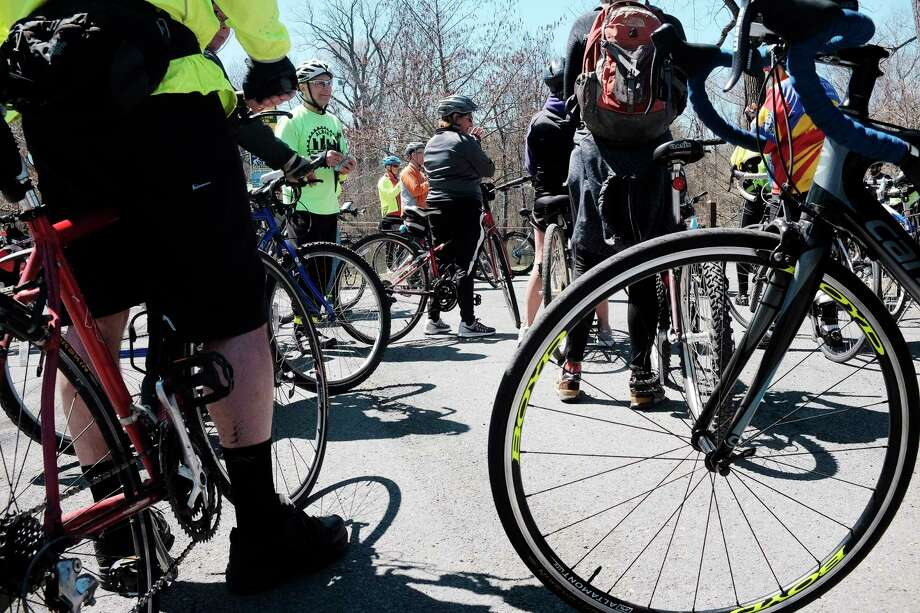 Bicycle riders make a stop at Buckingham Pond during the City of Albany's Annual Earth Day Bicycle Ride on Sunday, April 22, 2018, in Albany, N.Y. (Paul Buckowski/Times Union) Photo: PAUL BUCKOWSKI / (Paul Buckowski/Times Union)