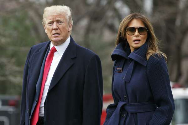 President Donald Trump and U.S. First Lady Melania Trump, right, walk on the South Lawn of the White House before boarding Marine One in Washington, D.C. on March 19, 2018.