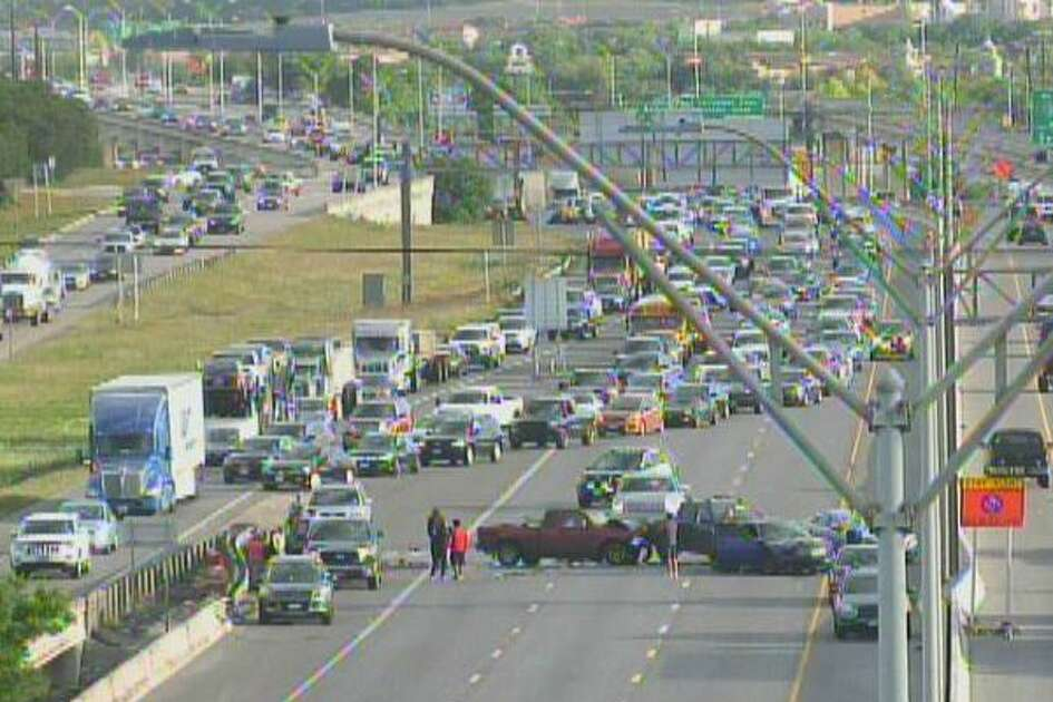 The eastbound lanes of Interstate 10 at Loop 1604 are blocked by several vehicles involved in a major crash.