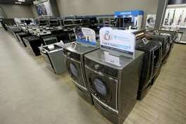 FILE - In this July 20, 2017, file photo, the Kenmore Elite Smart Electric Dryer and Front Load Washer, center, appears on display at a Sears store, in West Jordan, Utah. Private equity firm ESL Investments is offering to buy struggling Sear's Kenmore brand and home improvement unit. (AP Photo/Rick Bowmer, File)