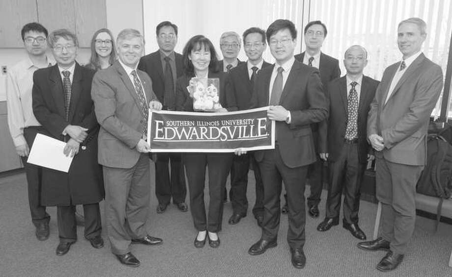 Pictured are, from left, Liang Ge, International Affairs; Keqin Gu, distinguished research professor, SIUE SOE; Rachel Webb, SIUE lead international immigration advisor; SIUE Chancellor Randy Pembrook; Wen-Bin Xu, deputy dean, CIT School of Computer Science and Engineering; Mary Weishaar, executive director, SIUE International Affairs; Hong Qingfu, dean CIT School of Foreign Languages; Jiang Xue Fan, director, CIT Office of International Cooperation and Exchanges; Gen-Hua Zhang, CIT vice president; Cem Karacal, Dean SIUE SOE; Fuxing Zhu, vice dean, CIT School of Economics and Management; and Jim Monahan, director of SIUE International and Graduate Admissions. Photo:       For The Telegraph
