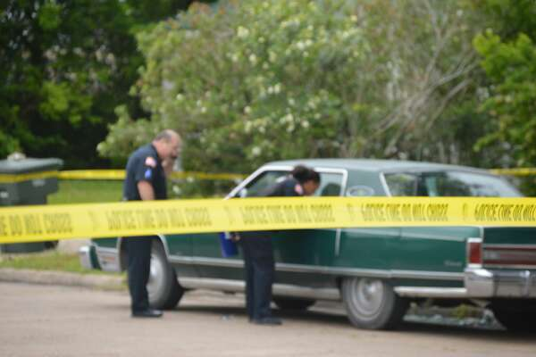 Port Arthur police investigate a shooting Sunday, April 22, 2018 in the 100 block of W. 14th Street. Photos provided by Eric Williams.