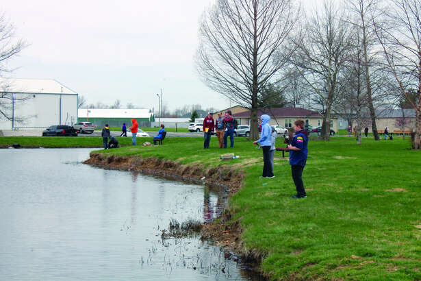 Participants line the banks of the lake at Drost Park Saturday morning as they take part in the annual Maryville Fishing Derby. The catch-and-release event was conducted by the Maryville Parks and Recreation Department and the SIUE Bass Masters Club. The derby was open to youngsters up to age 15 and included hot dogs, chips and drinks after the one-hour fishing competition.