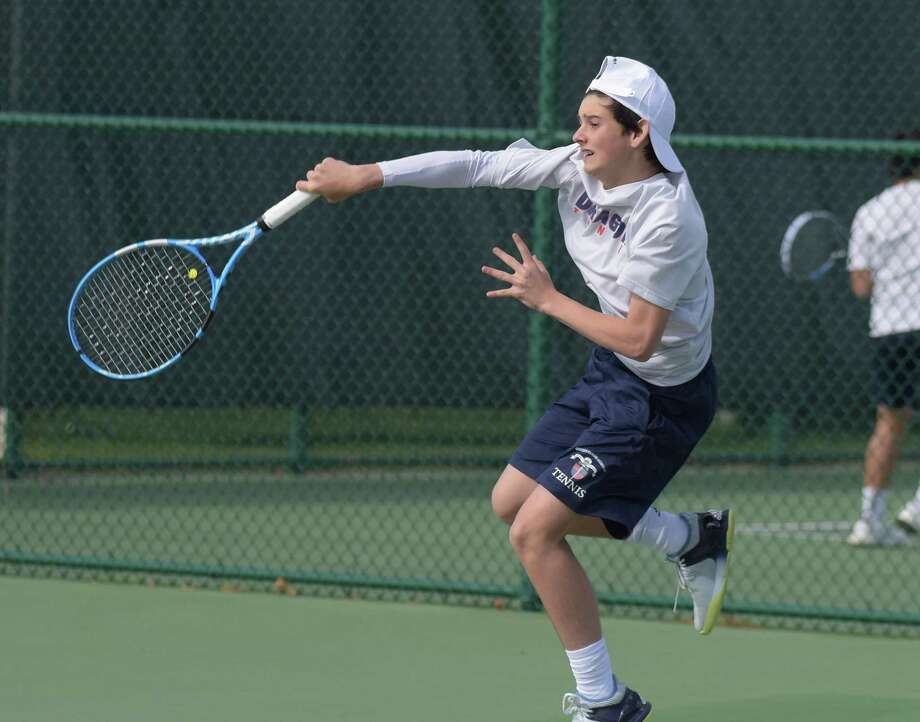 GFA boys tennis player Will McDonld, a resident of Westport, hits a return during the team's home match against St. Luke's last week. The Dragons beat the Storm twice last week. Photo: Greens Farms Academy Athletics