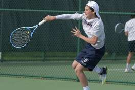 GFA boys tennis player Will McDonld, a resident of Westport, hits a return during the team's home match against St. Luke's last week. The Dragons beat the Storm twice last week.