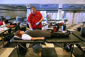 University of Bridgeport Event Coordinator Denise Brady donates blood during a Red Cross blood drive held at the school's student center in Bridgeport, Conn., on Wednesday Jan. 24, 2018. The American Red Cross is calling for donors to give blood and platelets regularly to be prepared to meet the needs of patients in emergency situations.