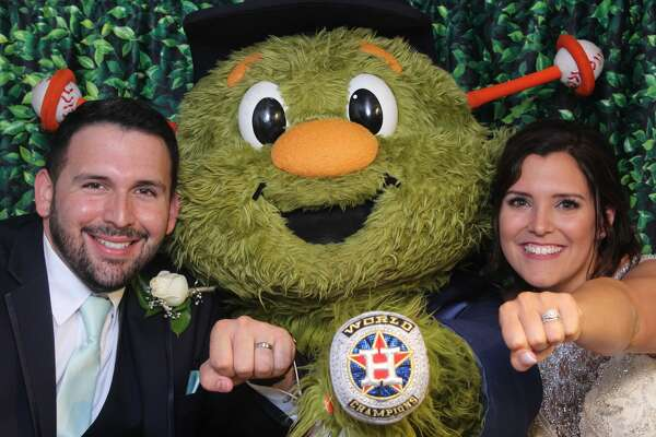 Marissa and Bryan Tucker joked with their friend Colton Davis  about having Orbit at their wedding and nine months later, he delivered with the ultimate wedding gift.  The Cypress Photo Camper  was able to capture a few of the couple's moments with the Astros mascot.