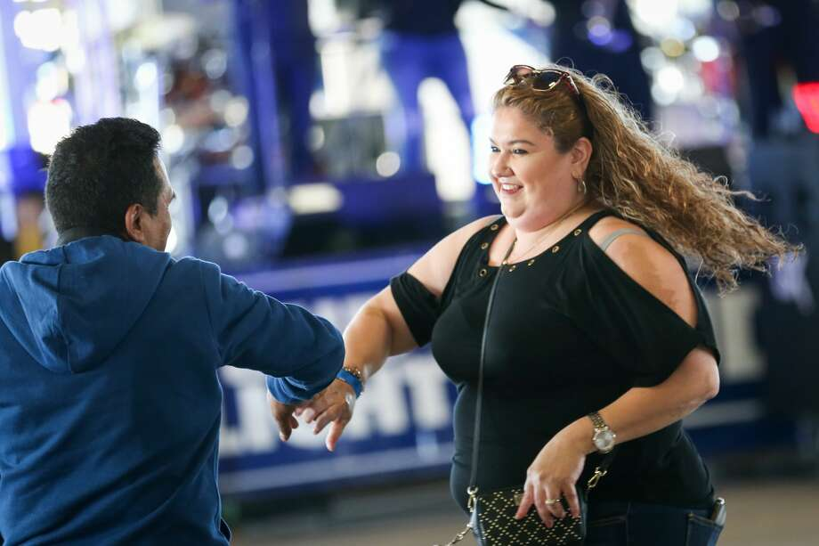 Attendees of El Dia de la Familia Hispana dance to music played by Internacional Sonora Carnaval at the Montgomery County Fair on Sunday, April 22, 2018. Photo: Michael Minasi/Houston Chronicle