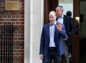 Britain's Prince William waves as he leaves the Lindo wing at St Mary's Hospital in London London, Monday, April 23, 2018. The Duchess of Cambridge gave birth Monday to a healthy baby boy — a third child for Kate and Prince William and fifth in line to the British throne.