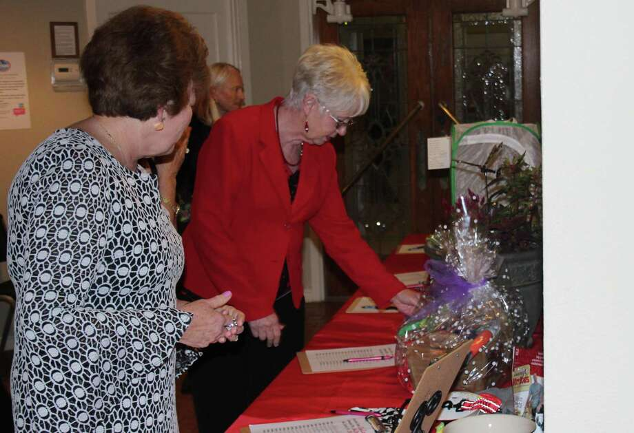 Visitors at the Coldspring-Oakhurst Education Foundation's Red and Black Gala peruse various items up for silent auction on April 21. Photo: Jacob McAdams / HCN