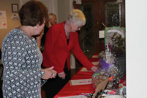 Visitors at the Coldspring-Oakhurst Education Foundation's Red and Black Gala peruse various items up for silent auction on April 21.