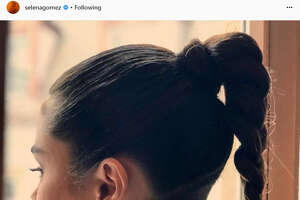 Texas native and singer Selena Gomez shows off her newly-shaved head on social media in a post on April 23, 2018.   Source:  Instagram