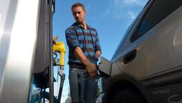UTSA student Michael Gomm fills up at the Valero Station at 5602 UTSA Blvd on Friday, Oct. 31, 2014.