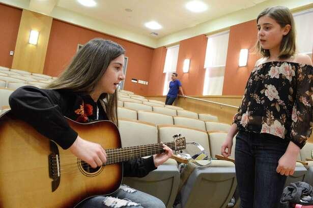 "Anya Napoli, 12, left, and Rica Monaghan, 13, of Darien, practice ""Work Song"" at the Teen Talent Show held at Darien Library, Saturday, April 21, 2018, in Darien, Conn."